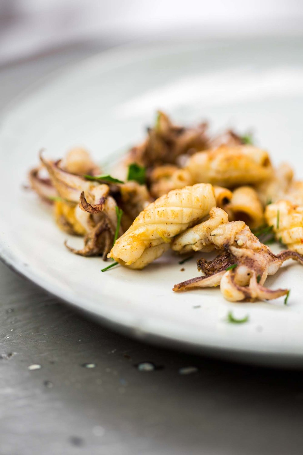 Ingredients - Baby squid, cleanedZest of a lemonChopped parsley½ tbsp of HarissaWe served the squid as a topping for Harrisa braised squid with saffron chickpeas, burnt lemon & garlic toastbut equally good served as a appetizers with some homemade aioli