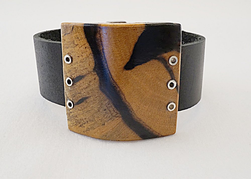 Black and white ebony wood with sterling silver rivets with black leather strap