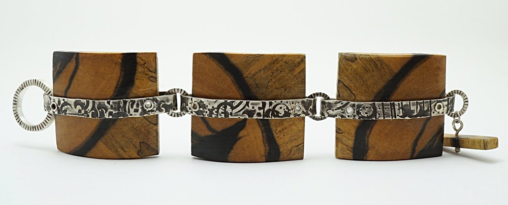 Hand carved black and white ebony wood links with hand stamped sterling silver connectors and toggle