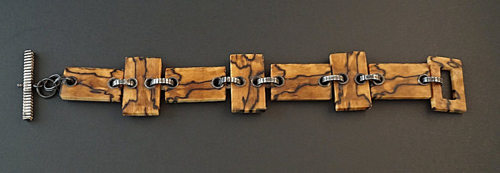 Hand carved spalted hackberry wood links with sterling silver textured connectors and toggle