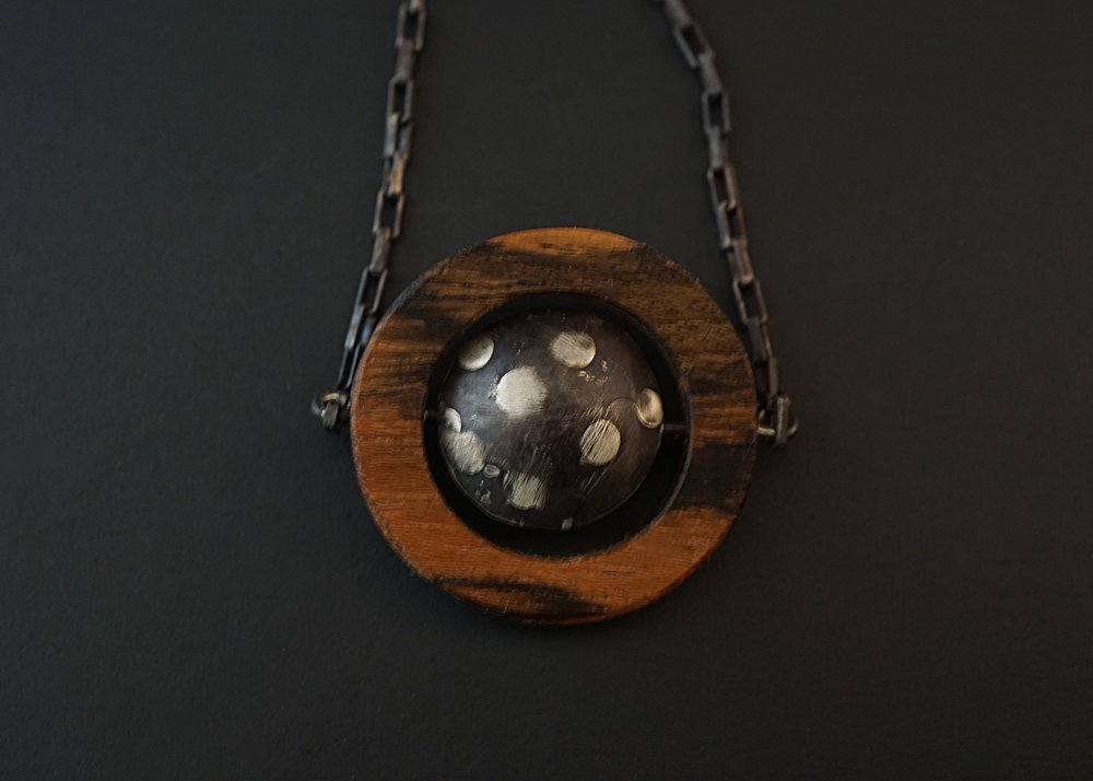 Domed sterling silver bocote wood pendant