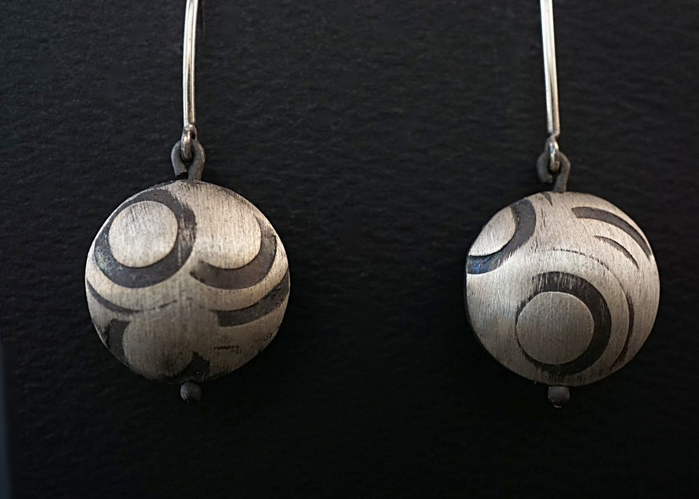 Hand stamped and domed sterling silver earrings