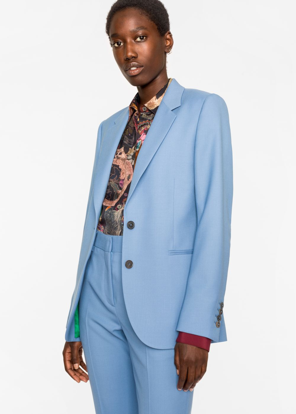 This is the blue version of the green above. Blue is a hot colour right now and is a good alternative if you can't deal with all of the red.  Jacket   and Trouser  both Paul Smith.
