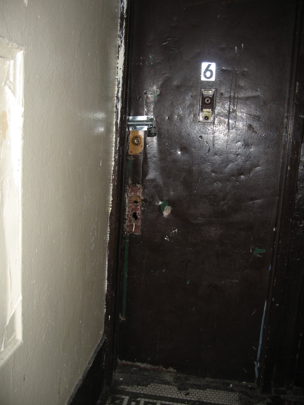 OLR MM- Hallway apt door BEFORE.JPG