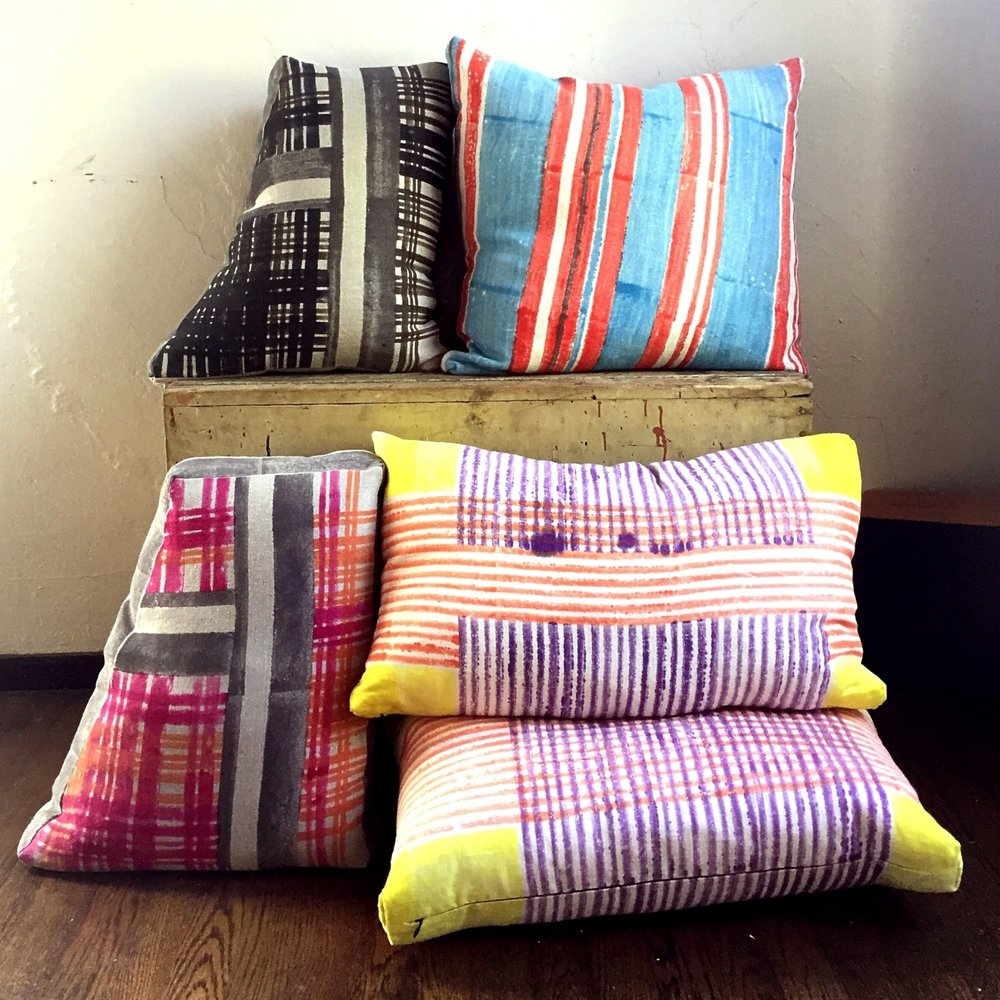 Trapezoid pillows in Scaffolded Plaid, Dawn and Night Colorway. Tilt Canter in Brite Perennial, Enmesh in Pismo. Block printed on natural and cream linen canvas.