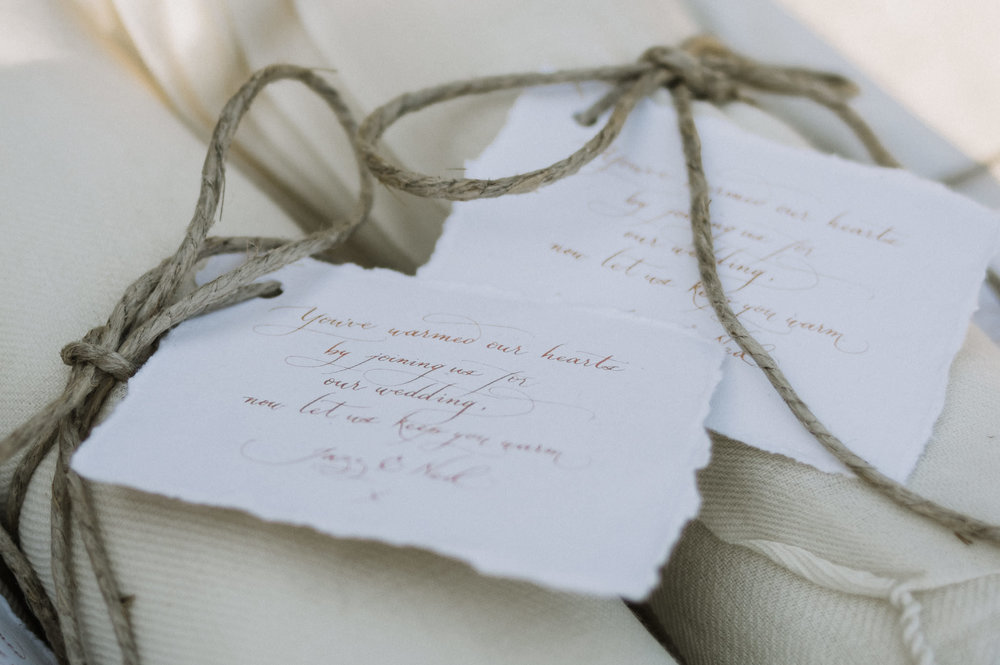 Welcome tags on handmade cotton paper  Photo by  Adam Levi Browne Photography