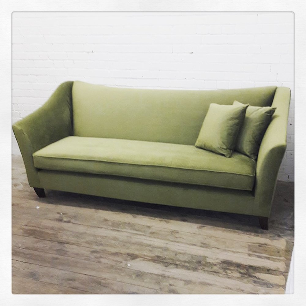 curved sofa olive green