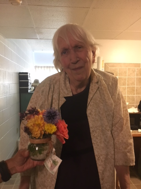 Karen Crane with Flowers, 8-9-2018.JPG