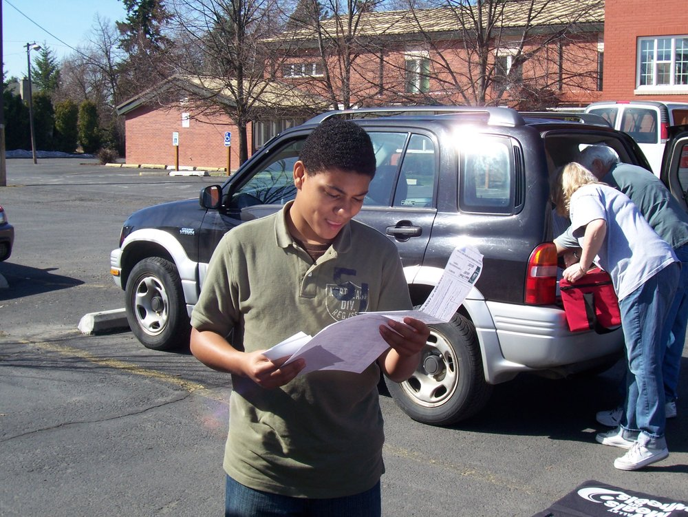 Volunteer looking at route sheet.jpg
