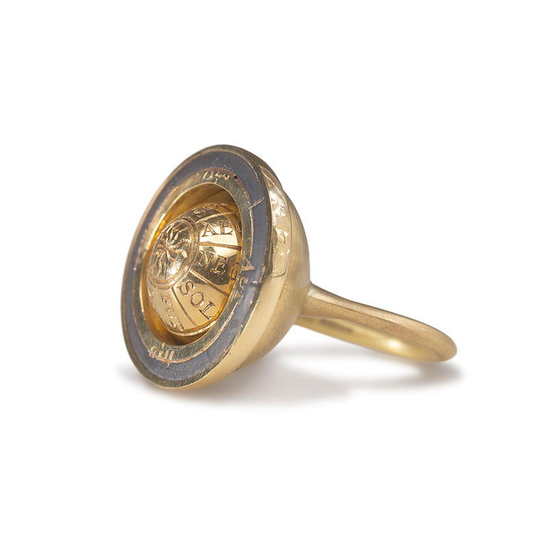18ct gold engraved rotating armillary ring and oxidised silver