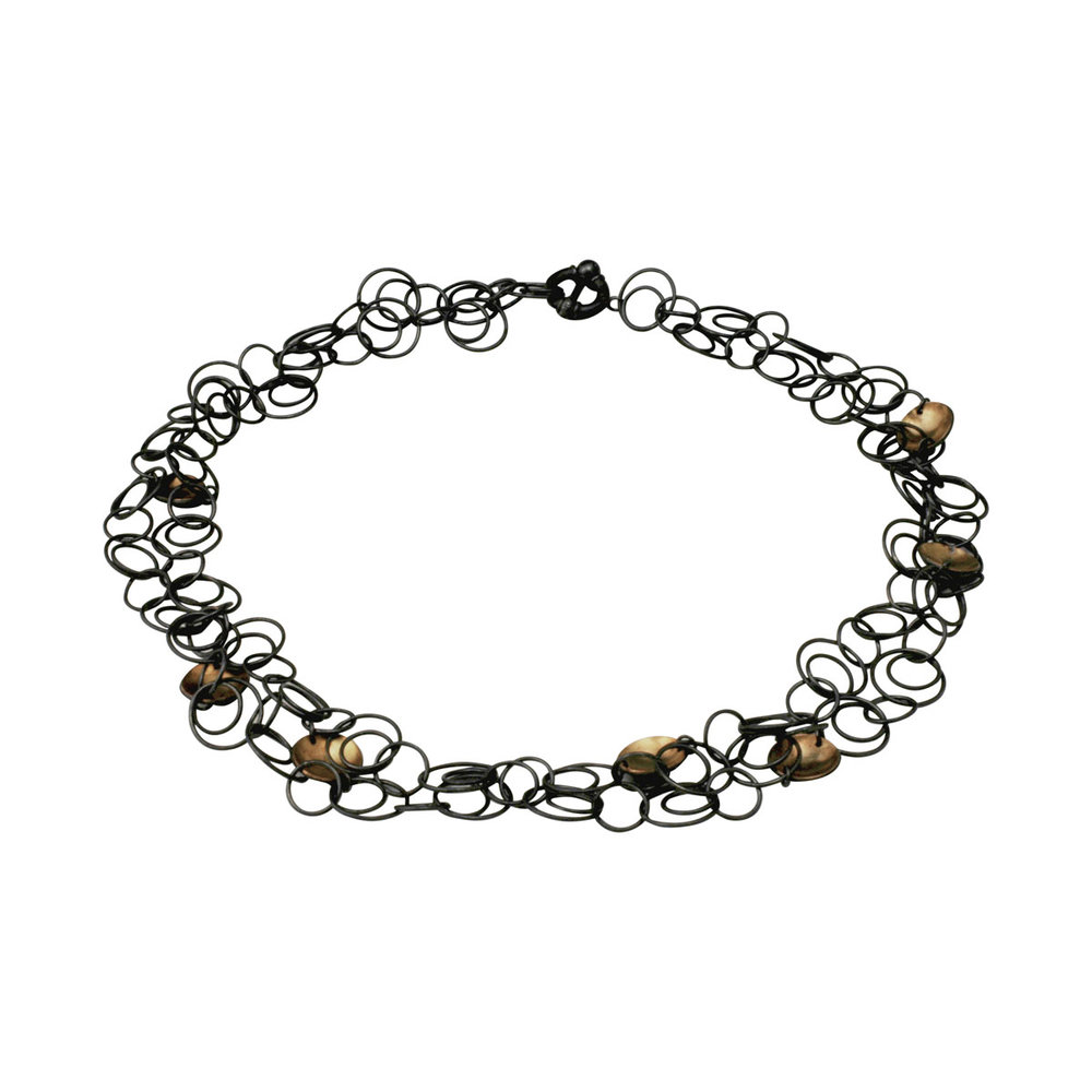 Oxidised silver orbital necklace with gold plated hemispheres