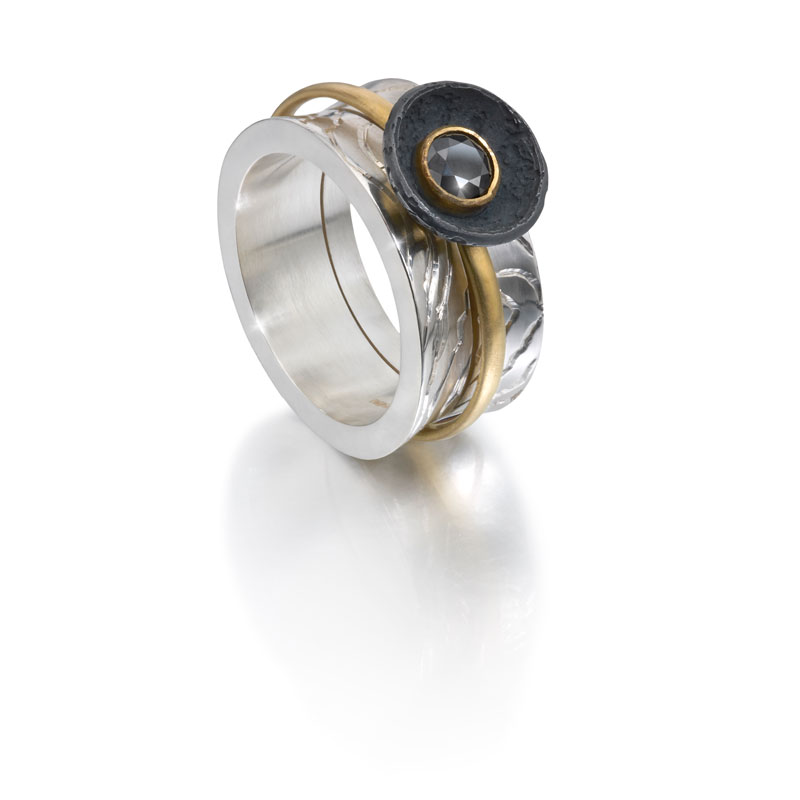 Black rhodium plated silver outer ring, 18ct gold inner ring with black diamond