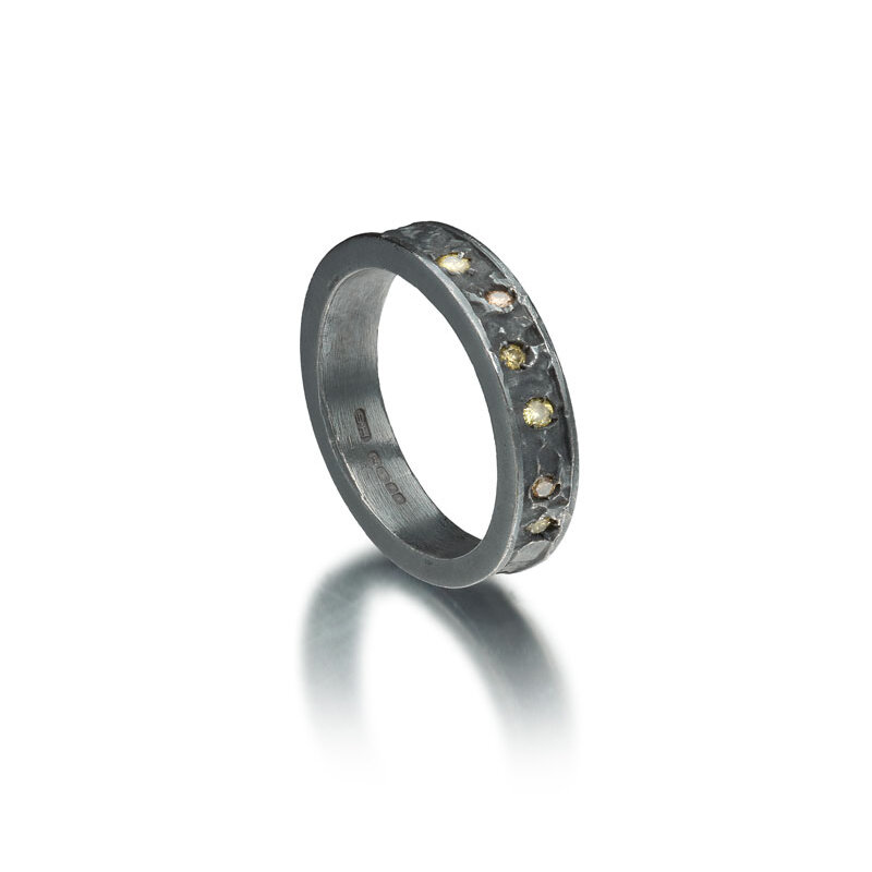 Black rhodium plated etched silver ring with diamonds