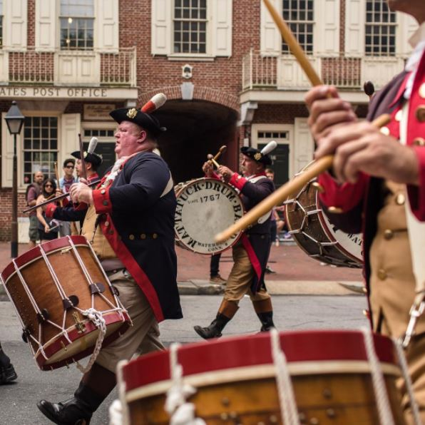 The Mattatuck Drum Band, the oldest fife and drum band in the United States with continuous membership since its founding in 1767 displays historically accurate period costumes on Market Street. Image Courtesy of @stanleyphoto