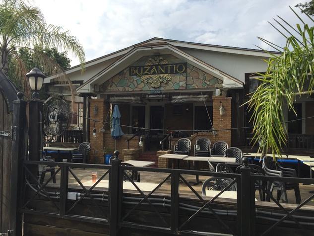 Popular Greek Souvlaki Restaurant And Hookah Bar Shutters In