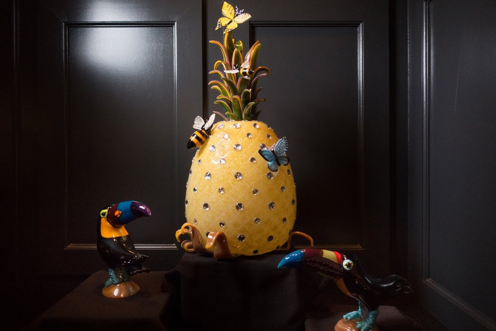 Brian Rubino's intricate glass pineapple structure on display at The Alise Chicago.