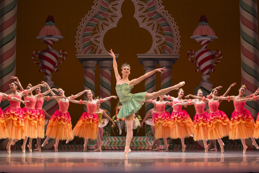 Pacific Northwest Ballet corps de ballet dancer Elle Macy as Dewdrop, with company dancers in a scene from George Balanchine's The Nutcracker®, choreographed by George Balanchine © The George Balanchine Trust. PNB's production features sets and costumes designed by children's author and illustrator Ian Falconer (Olivia the Pig) and runs November 24 – December 28, 2017. Photo © Angela Sterling.