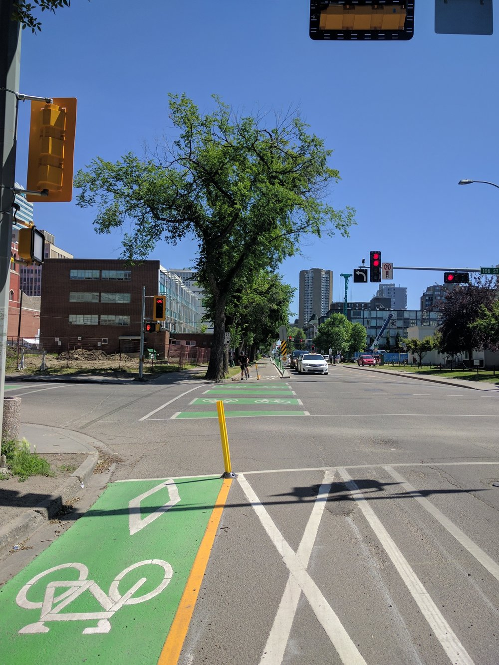New bike lanes on 100th avenue in downtown Edmonton. Photo credit: Helen Frost.