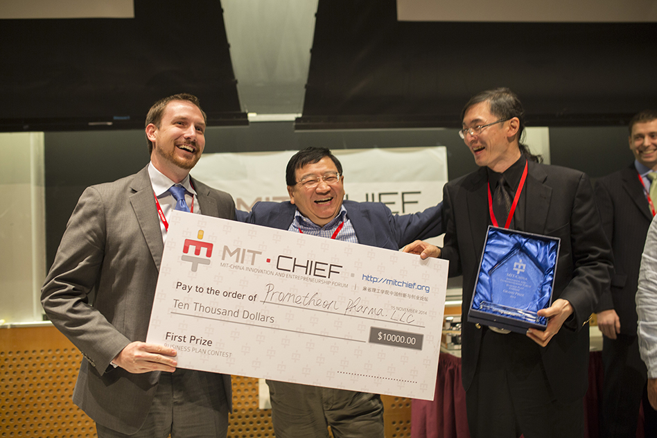 Prometheon Pharma team members Devon Grimmé (left), director of business development, and Stephen Hsu (right), CEO, with business plan competition judge Bob Xiaoping Xu (center), founder of the Chinese seed-fund firm ZhenFund