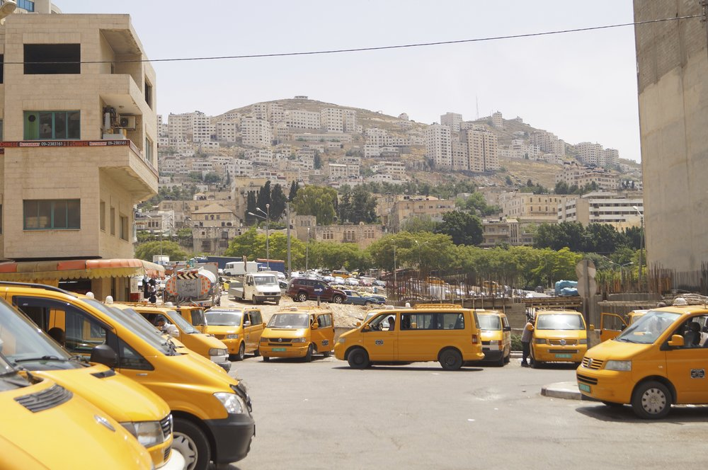The service cars used for transportation in occupied Palestine are yellow caravels. This is the station in Nablus.