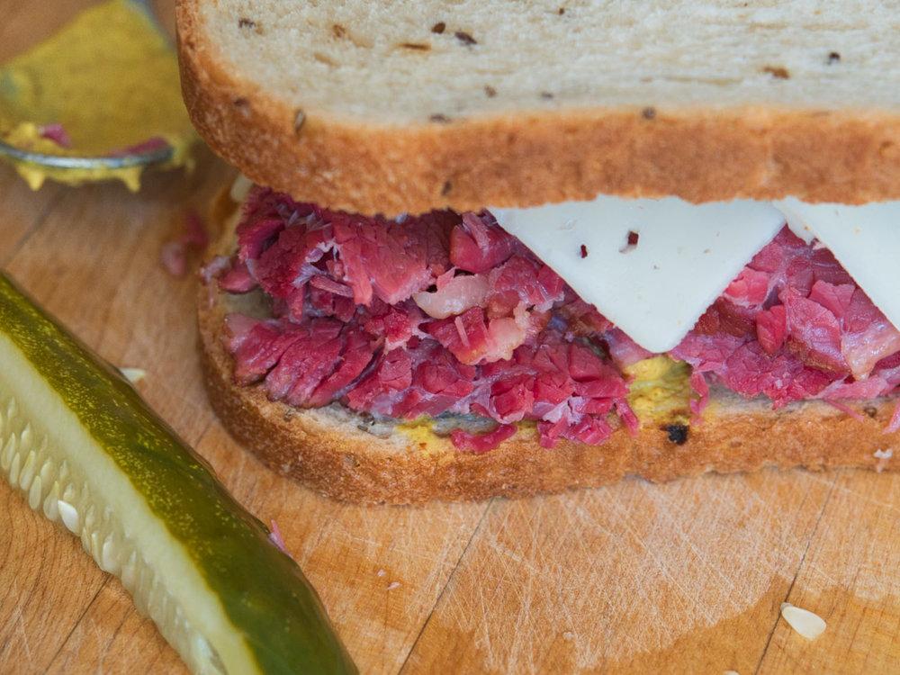 Corned beef, swiss cheese, sauerkraut, and mustard on rye bread... Yum!