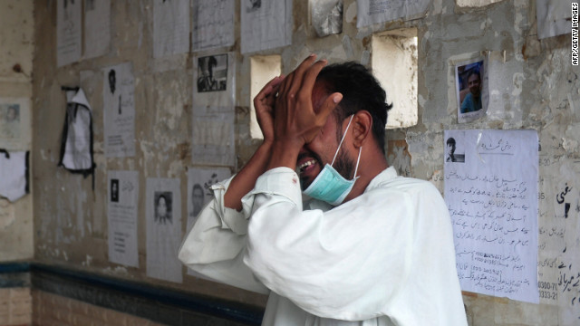 A Pakistani man weeps for his relative who was killed in the garment factory fire.