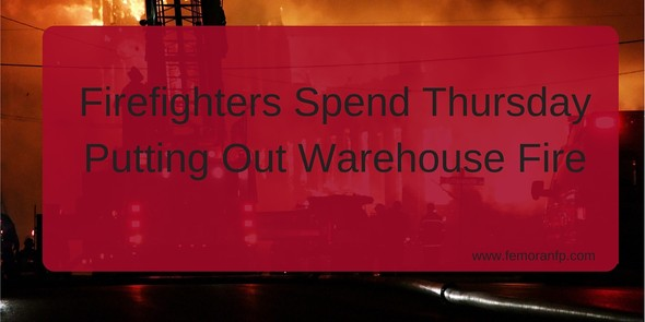 Fire sprinklers contain warehouse fire
