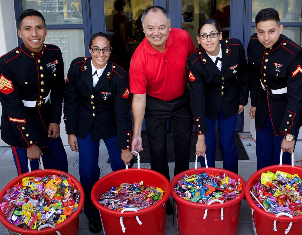 United States Marine Corps troops giving a helping hand at the Candy Buyback event.