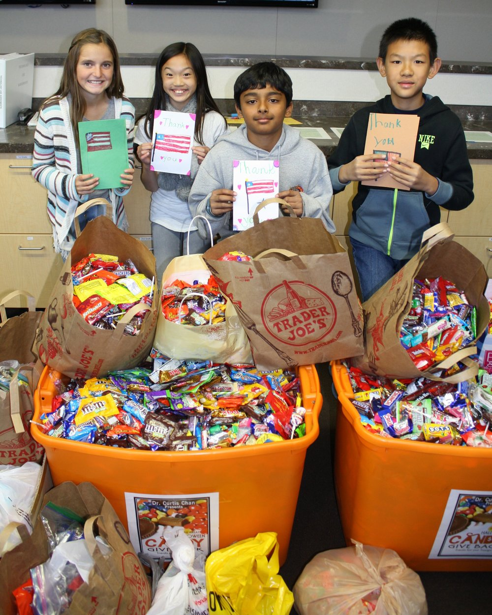 Children with the letters of gratitude they have written for overseas troops.