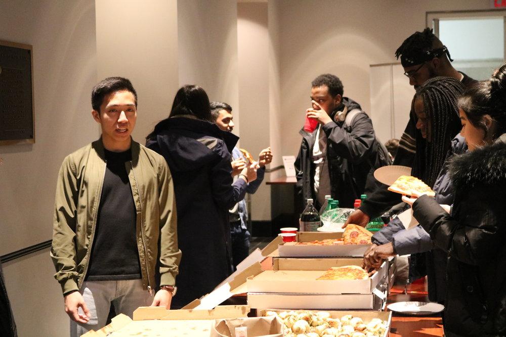 E-Board Members Eating Pizza