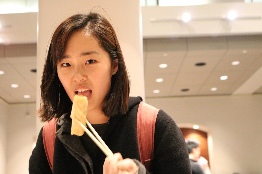 A Student Eating an Egg Roll
