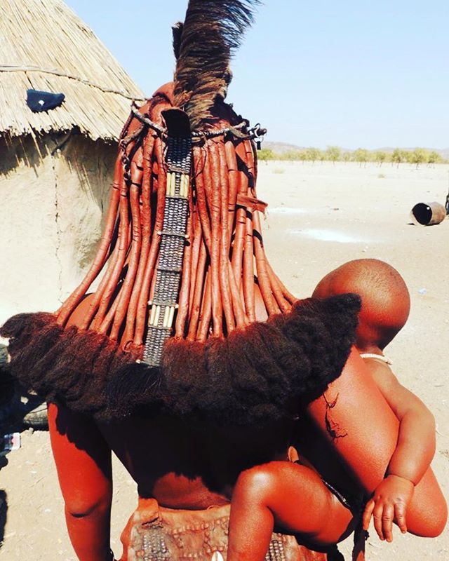 Himba women's Hair . Hair and hairdressing play a significant role among the Himba as they indicate the social status of each individual within the community, young girls use to dress their hair with two braided hair plait extending forwards, whereas after the puberty, hair are worn down and numerous rasta braids are made and covered with the same butter and ochre paste used for the body.  The hairstyles of the Himba women are true masterpieces, when a woman is married she wears a sort of diadem made from antelope hide, called omarember or erembe; widows wear this singular hat in reverse. . #himbawomen #hairstyles #redochre #butterfat #dreadlocks #redpaste #traditionalstyle #indegeniouspeople #namibia #lolalovecargostyle #sisterhoodoflolalovecargo