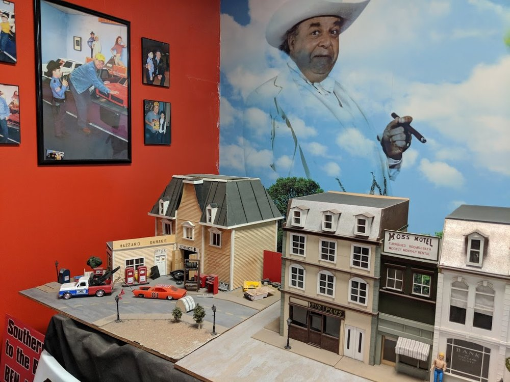 A scale model of town presided over by an oddly heavenly Boss Hogg? What could be more heavenly than that?