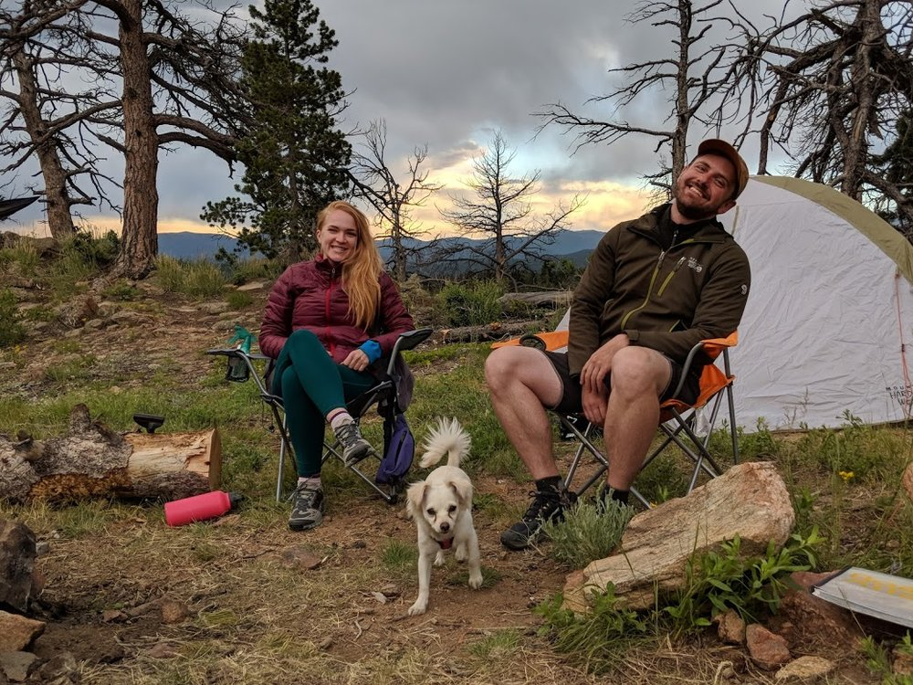 Andrew, Jerilyn, and canine companion (and first-time camper) Luna easily approximate the cover of an REI catalog.