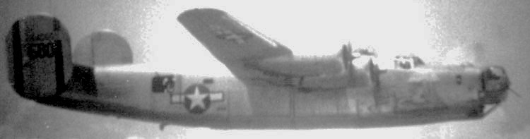 Flying in formation over Mindanao, Philippine Islands. Angaur Island, 6 Apr 1945, this is the only known still photograph of the  Lady  in flight, courtesy of past historian of the 494th BG, James Leddy, son of T/Sgt Donald Leddy.