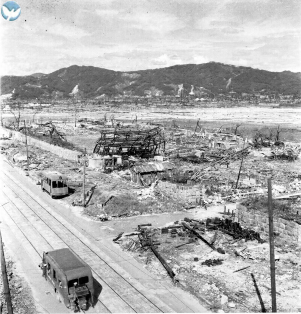 Destruction of the Chugoku Military Police Headquarters is in the background of this image from the Hiroshima Peace Memorial Museum.