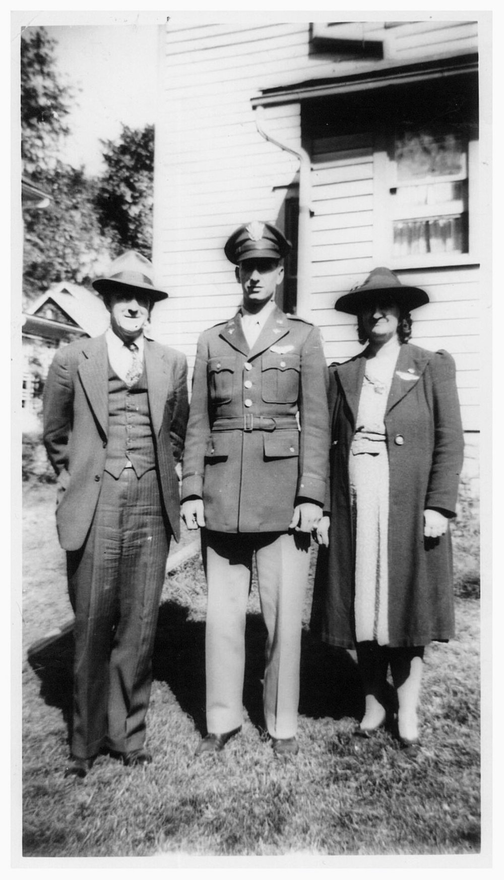 Members of the family of 2nd Lt. James Ryan: Father Thomas and mother Marion, in front of their home in September, 1944.  All three of the sons served in the military. Mother, Marion, after learning that James was missing in action, repeatedly called radio stations asking for news information on his whereabouts.