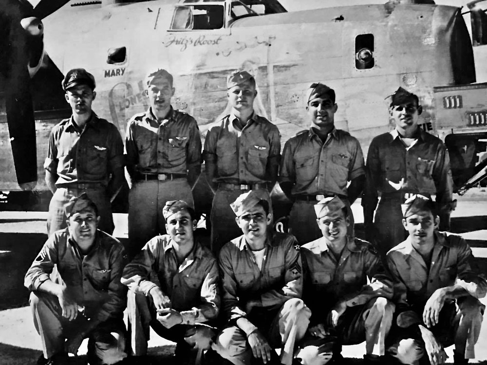 "Turek's Crew #39. Standing, left to right: Emil M. Turek, Francis ""Fritz"" Johnson, Rolf Slen, Vito ""Dave"" Nacci, and Lee Colvin  Kneeling, left to right: Gilbert W. Higgenbotham, Rex Reeves, Alfred ""Al"" Emery, Alton Holloway, and Richard ""Dick"" Bennett."