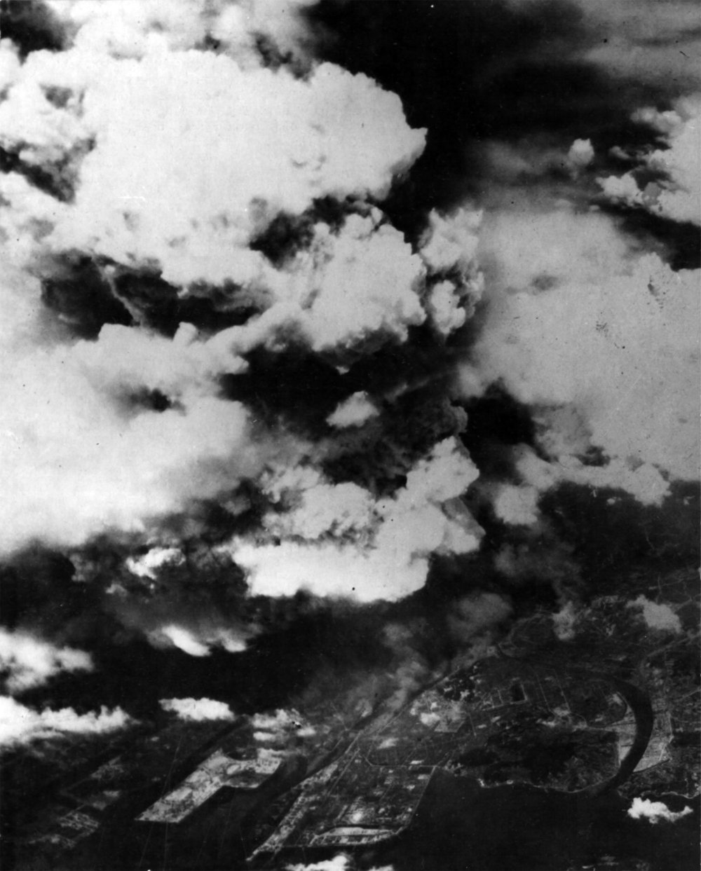 The mushroom cloud that appeared in the sky above Hiroshima. The  Enola Gay  dropped an Atomic Bomb above Hiroshima from the altitude of 9,600 m at 8:15a.m., August 6, 1945. The Atomic Bomb exploded 43 seconds later at the altitude of around 600 m above Hiroshima, with a strong flash: one second later, a gigantic ball of frame emerged, the diameter of which was around 280 m.  The   mushroom clouds rose up to the altitude of around 10,000 m, the lower edge of the stratosphere. (きのこ雲は通常、ひとつの写真が多いですね。この写真では複数なので、一応複数にしました。)