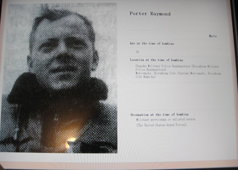 A tribute to Raymond Porter and recognition of his death as an American POW who was killed by the first atomic weapon is shown in this screen capture from the Peace Memorial Hall in Hiroshima.