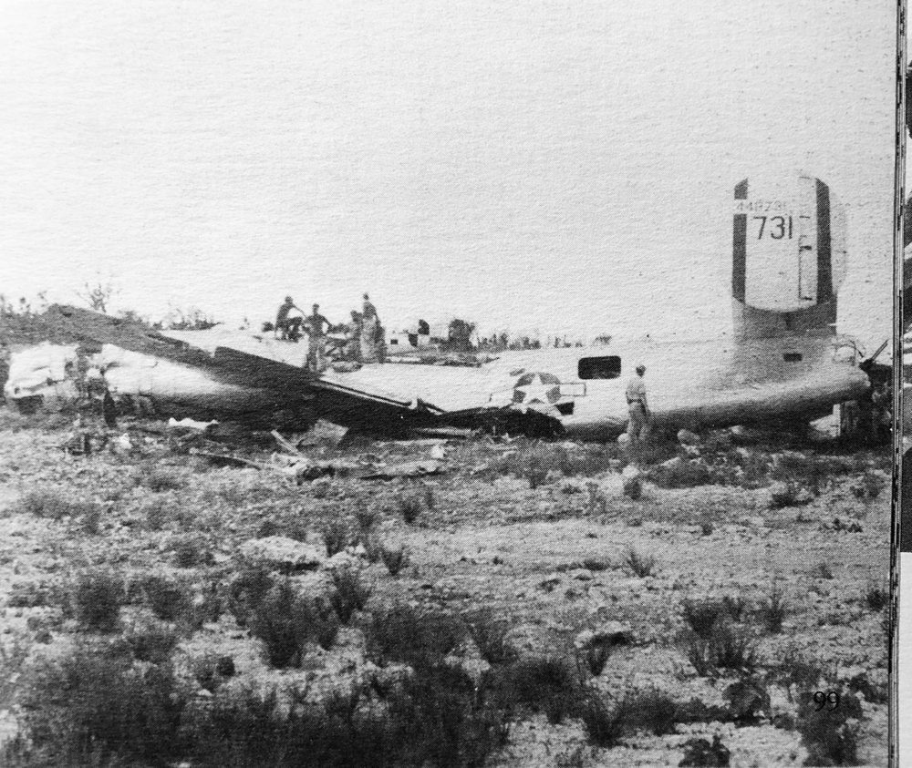 """The wreckage on Angaur, Palau, of Joe Dubinsky's crew's B-24 """" 'Til Then """". Although other crashes at and near this airfield resulted in fatalities, this was noted by a unit historian as perhaps the most dramatic crash. Rolf Slen chuckles over Turek's account."""
