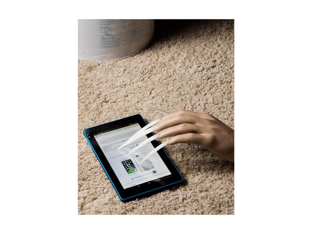Kieren Seymour   Used Iphone Ad , 2017 photograph on archival rag 62 x 53cm    ARTIST BIO