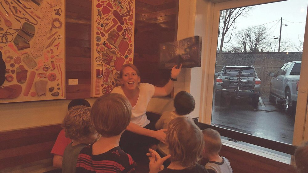 Co-Founder Amanda reading to the kids at our last event at Random Row!