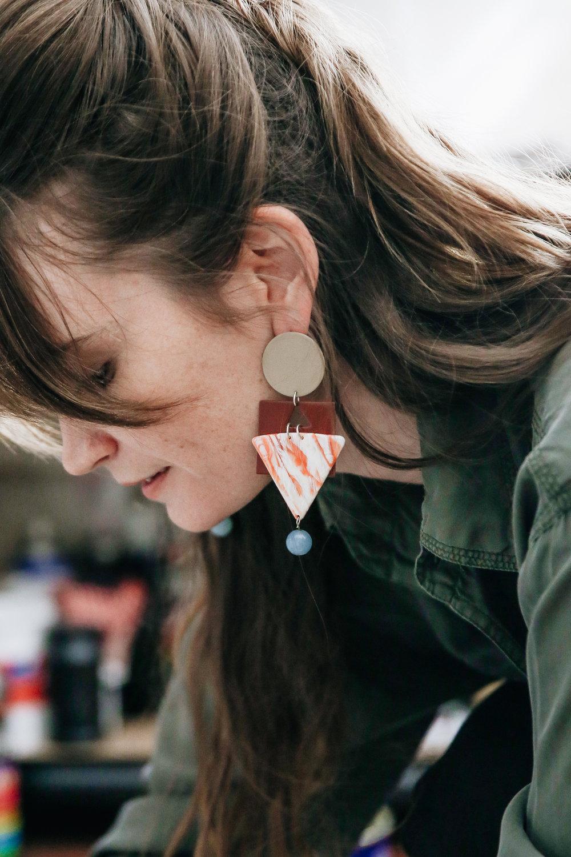 bridie wears the cleopatra earrings in tan