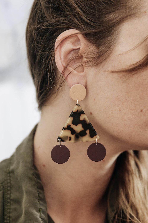 Bridie wears the  Terzetto earrings in peach