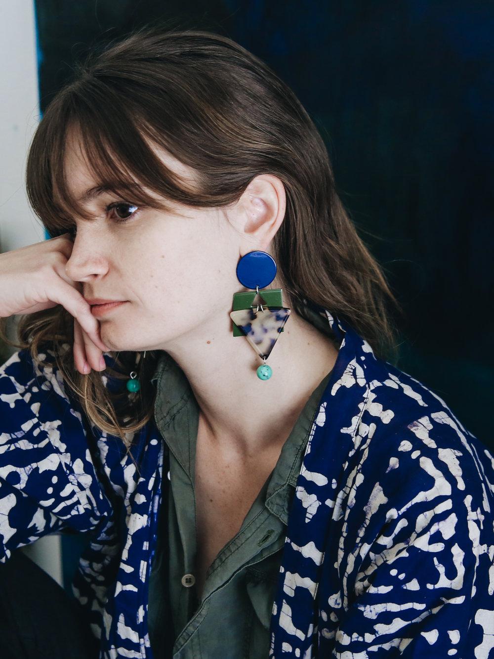 Bridie wears the  Cleopatra Earrings in Navy