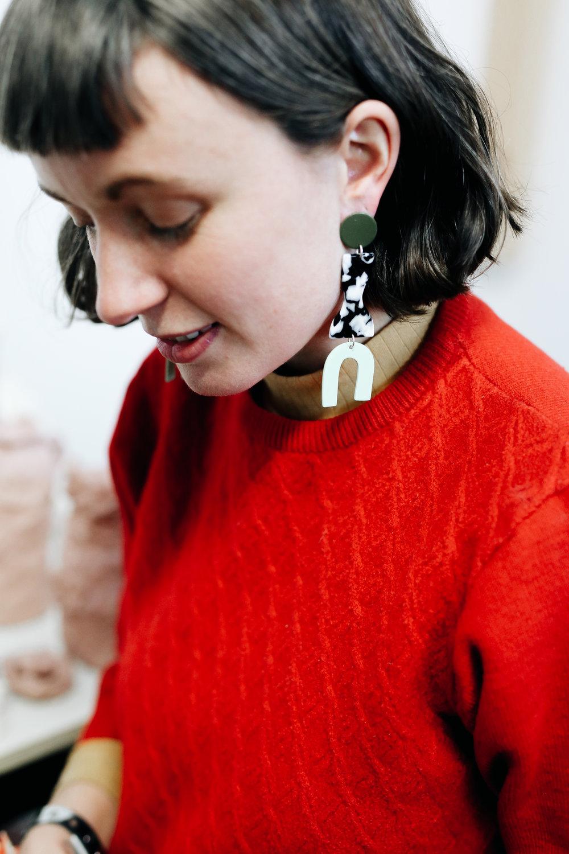 Tessy wears the roy earrings in army