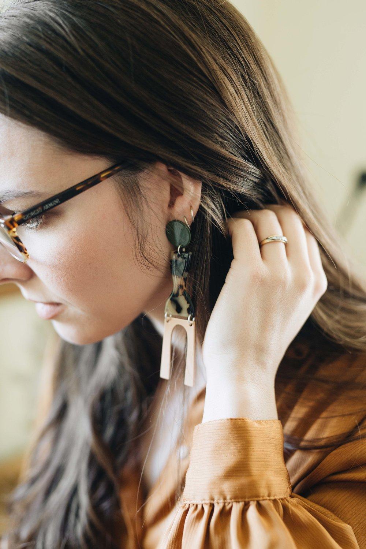 Nicolette wears the  Faro Earrings