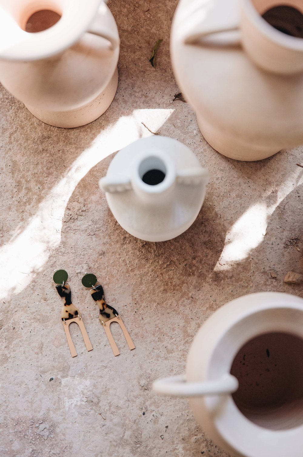 The Faro Earrings in Army hanging out on Nicolette's studio floor.