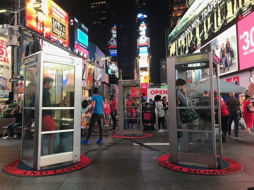 Tyler's art. Each phone booth rings, then tells the story of how the speaker got to NYC and how it saved them. Really cool.